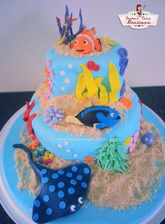 - Finding Nemo cake! Rich chocolate cake with chocolate buttercream, covered in chocolate ganache. All figurines are made from gumpaste and the sand is a mix of shortbread, white sugar and low GI sugar. Voila!  https://www.facebook.com/TashasCakeBoutique