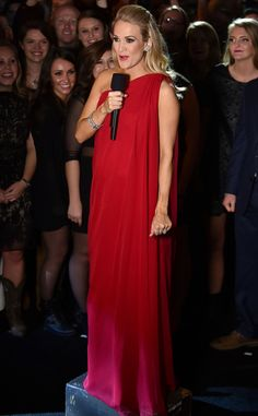 Red Goddess from Carrie Underwood's Pregnancy Style While hosting the 2014 CMA Awards, Carrie makes a quick wardrobe change into this stunning one-shoulder Pamella Roland design.