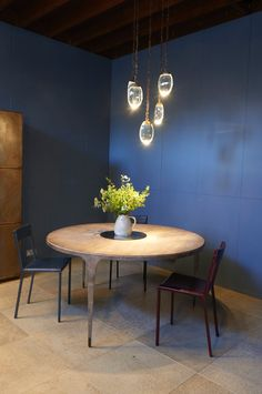 OCHRE Open in Pimlico - the whippet round table with sable leather chairs.