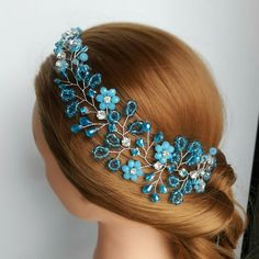 Stunning blue bridal hair piece for your winter or beach wedding! Delicious combination of turquiouse crystals, glass beads and blue rhinestones make this wedding hair accessory splendidly beautiful. Choose Deliziosa Accessori for your wedding!