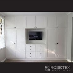BUILT IN WARDROBE DESIGNS. Built in wardrobe, dressing table and the TV unit all-in-one. The symmetrical design not only looks good but is very easily divided up into his and her sides. Diff color though! Wardrobe Wall, Wardrobe Design Bedroom, Master Bedroom Closet, Tv In Bedroom, Trendy Bedroom, Closet Wall, Wardrobe Handles, Closet Doors, Bedroom Ideas