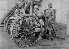 Sikh sepoys (Indian infantry soldiers in the British Indian Army) with a cannon and British officer. Sudan, 1898.