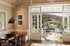 Sliding French Doors ... this one looks so airy bc it has windows above the door and then on either side of the doors