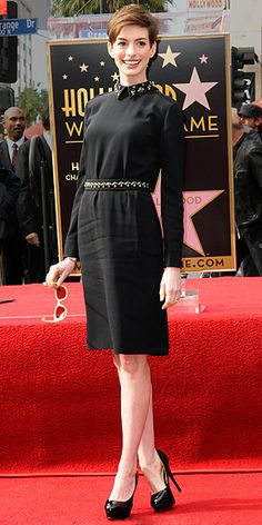 black collared Prada dress, Aldo pumps, Karen Walker sunglasses and an Ocnarf Sairutsa ring (sec 2012)