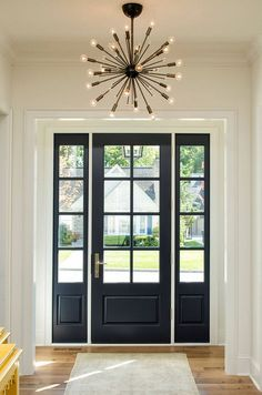 The designer chose to paint the interior of the door and sidelights in the same paint color; Benjamin Moore Hale Navy HC-154.