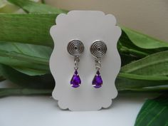 A personal favorite from my Etsy shop https://www.etsy.com/listing/493846543/purple-rhinestone-dangle-magnetic