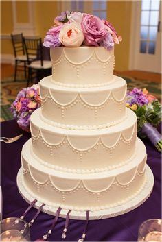 Classic white wedding cake with flower cake topper ~ Photo: JW Baugh Photography