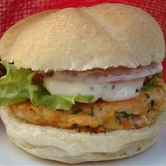 Yummy Lemon Salmon Burgers Allrecipes.com - we NEVER eat these on a bun. EVER. They are superb just as their own main dish. The Lemon-Basil mayonnaise, however, is a MUST. It complements the salmon burger beautifully. I've made this in a mini-size as appetizers for a party before.