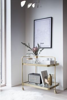 A calm corner of my sitting room. Poster - Grafomap / brass bar cart - Nordal.