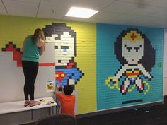 When the walls at your work get boring, office superheros made from post it notes.