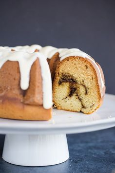Cinnamon Coffee Cake with Cream Cheese Icing :: This old-fashioned cinnamon coffee cake is baked in a Bundt pan, full of cinnamon swirls, and topped with a simple cream cheese icing. Easy and delicious!