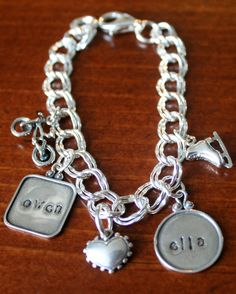 This sterling silver large double link bracelet is available in 7″, 8″ or 9″ and includestwo Raised Rim name charms. The Raised Rim charm is available in a circle (allows seven letters in Block Font or five in Fancy Font), square (allows seven letters in Block Font or five in Fancy Font), or rectangle(allows five letters in Block Font or four in Fancy Font). You pick your desired combination.