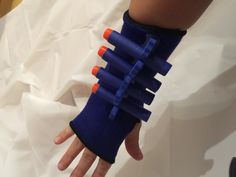 Nerf Dart Sleeve! Perfect for storing darts while in battle! Dollar store ankle support (2 for $1) and pedicure toe separators, a little hot glue and there you have it!