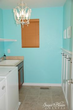 My aqua laundry room!  Almost done, just a few finishing touches that need to be completed, including getting rid of those ugly brown blinds & putting up a fabulous window treatment!