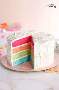 Rainbow Layer Cake #recipe. Our Spring 2014 cover cake wins rave reviews. It's fun, colourful and a slice of party-dessert perfection. http://www.kraftcanada.com/recipes/rainbow-layer-cake-161053