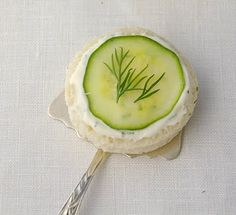 cucumber sandwich  1 (8 oz.) pkg. softened cream cheese  1 stick butter, softened  1 pkg. Good Seasons mild Italian dressing (dry)  1 (8 oz.) loaf party rye bread  2 cucumbers, unpeeled & thinly sliced  Dill weed for garnish    Combine cream cheese, butter and dressing mix. Refrigerate for several hours or overnight. Spread on each slice of bread, top with cucumber slice and sprinkle with dill. Serve immediately.  Makes about 3 dozen.    NOTE: Especially good in summer when cucumbers are best.