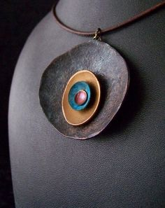 New Metal Pendants by Polygolems. This unique necklace is handmade using a fairly new process in the polymer clay world. The individual components of the necklace are hand fashioned, cured, then painted with a special metallic surfacer. Ceramic Jewelry, Enamel Jewelry, Copper Jewelry, Leather Jewelry, Leather Cuffs, Polymer Clay Necklace, Polymer Clay Pendant, Clay Beads, Jewelry Crafts