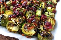 The perfect way to serve up Brussels sprouts, these ones are topped with bacon, cranberries and drizzled with a balsamic vinegar reduction!