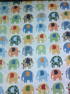 Quilting Craft Cotton - Ivory with Cute Patterned Elephants in Multicoloured! #cotton #elephant #quilting #craft #material #fabric #kitch