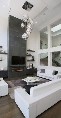 #homedesign #livingroomdecor #inspiration   This is an example of a contemporary open concept living room in Toronto with white walls, dark hardwood floors, a ribbon fireplace and a wall-mounted tv. — Houzz Source