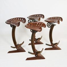 One-off barstools, with tiller V-blade bases. Vintage steel tractor seat mounted on a custom fabricated curved post.