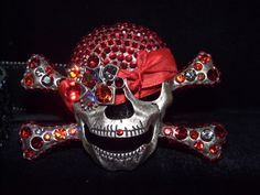 Designer Swarovski Crystal Pirates, my biggest sellers. Each buckle is made with Swarovski Crystals & comes with a sequin belt. They unsnap and can be worn with other belts. limited edition color for each season. This one features a red/silver colored face with black belt.  I wear them with jeans, leather and more. Women love these buckles and men have also purchased them. $95 free shipping U.S.!  To Purchase with PayPal,Check, money order email Lisa@LisaLePaige.com