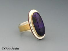 Chris Pruitt - Sugilite Ring: Sterling silver, 18k gold, Sugilite Cabachon and Coral inlay