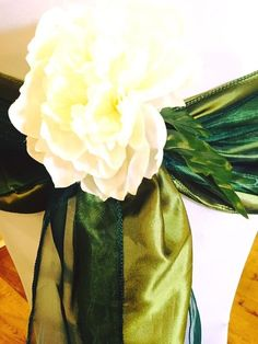 Olive green taffeta sash with dark green organza sash overlay, finished with cream peony  Want your own quote? Then email me with your ideas! hello@beckiemelvinevents.co.uk  More styles can be seen at www.beckiemelvinevents.co.uk
