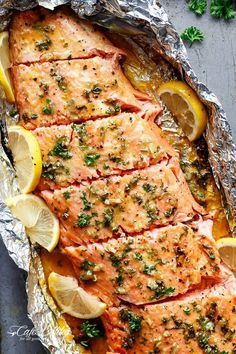 Honey Garlic Butter Salmon In Foil in under 20 minutes, then broiled (or grilled) for that extra golden, crispy and caramelised finish! So simple and only 4 main ingredients, with no mess to clean up!   cafedelites.com