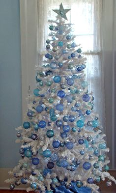 designer decorated christmas tree filled with white owls brown owls pine cones and other - Blue Christmas Trees