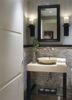 I like the sink, faucet, lower wall treatment and the the decor piece below (the wooden box with glass bowls and rocks.) 25 Modern Powder Room Design Ideas