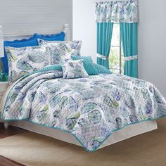 Beachside 3-Pc. Quilt Set Collection - printed in blue & green seashells & starfish on a white background that reverses to a blue & green stripe.  Set includes quilt & 2 standard shams. Also available is a matching Valance (shell print)  & striped Panels w/ seashell tiebacks.