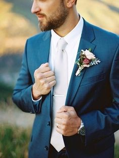 The groom's boutonniere is one of the few accessories for the groom. The small boutonniere declares the identity of the groom. The groom's boutonniere should be based on simplicity and smallness. Remember, the boutonniere and Read more… Blue Suit Wedding, Wedding Men, Wedding Groom, Wedding Suits, Wedding Attire, Dream Wedding, Wedding Themes, Rustic Wedding, Wedding Ideas