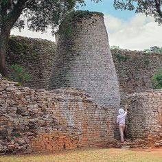 in his element - true explorer styles We visited the Great Zimbabwe Ruins which were built in the Century. People often think of Africa's huts but don't realise that Africa too had a network of big cities. Zimbabwe Africa, 11th Century, Prado, Safari, Cities, Explore, Adventure, Big, Building