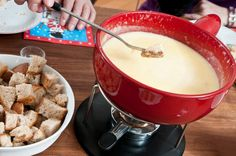 A typical Swiss fondue (melted cheese & wine). The origins of the dish remain mysterious. It dates as far back as Homer's Iliad from around 800 to 725 BC, where it was described as a mixture of goat's cheese, wine and flour. Swiss Fondue, Vintage Menu, National Dish, Fondue Recipes, Wine Cheese, Melted Cheese, The Dish, Tasty Dishes, Places To Eat