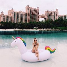 Rainbow unicorn pool float perfect for summer fun! Find more unicorn pool floats at AlwaysFits.com.