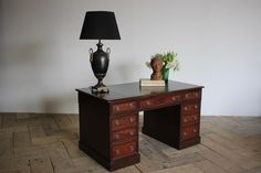 An early 19th century English pedestal desk in mahogany. The rounded rectangular top inset with black leather writing surface, above an arrangement of nine drawers on plinth bases. Pedestal Desk, Antique Desk, 19th Century, Drawers, Black Leather, Surface, English, Writing, Antiques