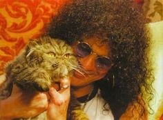 Slash of Guns 'N Roses and  his Persian cat. :) He's a big animal lover! So excellent.