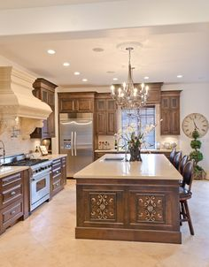 You don't see stove hoods like that in every kitchen turning this from a nice kitchen to a stand out kitchen.