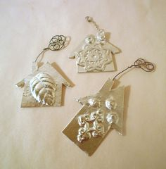 Little Silvery House Ornaments, upcycled from cardboard and duct tape.