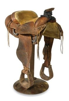 saddle barstool reminds me of the bar in jackson hole wy where all the barstools are saddles