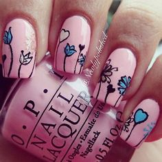 Simple yet cute looking pink nail art design. The base color used for this design is pink with black polish for the outlines. White and blue colors are used for the flowers.
