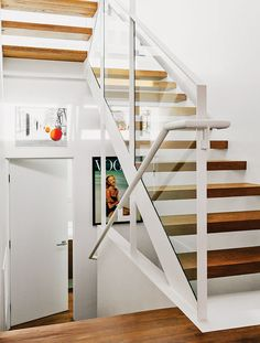 """""""The treads are open because we wanted to have as much light come down as possible,"""" says Dimster. Tagged: Staircase and Metal Railing. Photo 7 of 15 in A Midcentury Home Enjoys Views from Every Angle. Browse inspirational photos of modern staircases. Stair Steps, Stair Railing, Banisters, Stainless Steel Staircase, Door And Window Design, Dream Beach Houses, Modern Stairs, Mid Century House, Basement Remodeling"""