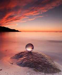 In to the future ::A crystal ball rests perfectly balanced on a rock during a beautiful sunset:: A lovely image Crystal Sphere, Crystal Ball, Crystal Magic, Glass Ball, Magick, Color Splash, Serenity, Cool Pictures, Sunrise