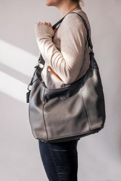 The Alex Hobo is a classic shape and features updated styling and details including brushed nickel hardware, contrast edge paint, and functional cross body and shoulder straps.The new pebbled Italian leather is striking in this season's colors. Painting Edges, Hobo Handbags, Season Colors, Brushed Nickel, Italian Leather, Shoulder Straps, Cross Body, Messenger Bag, Contrast