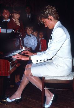 The Princess of Wales plays the piano to patients at the childrens hospital in Prague, May 1991