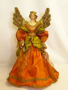 Orange and gold angel tree topper