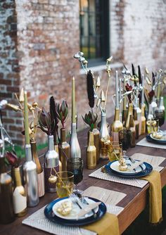 Love it when centerpieces are easy to recreate on your own. Grab cans of gold & silver spray paint, all those empty wine bottles, and go to town.