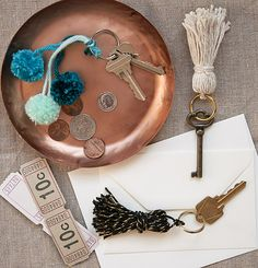 key chains made of DIY tassels and mini pom poms are easy and cute