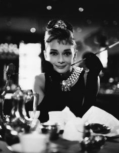 Breakfast At Tiffany's! A truly iconic and classic film! Holly Golightly's free spirited, crazy character is really uplifting and it's just a feel good movie!   PS: I like the song too!